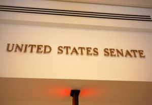A sign marks an entrance to the United States Senate in the US Capitol building. Source: shutterstock.com