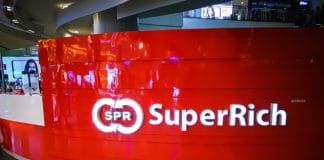 BANGKOK, THAILAND. – On May 11, 2018 - Superrich international money exchange, image shows trademark logo on its front counter branch in a shopping center. Source; shutterstock.com