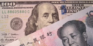 Chinese yuan and US dollar. Concept for trade war between China and the U.S. Source: shutterstock.com