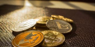 Family of cryptocurrency. Stack of shining golden and silver coins with sunlight on background. Crypto group. Ripple and litecoin dominance, Warm colours - photo of crypto coins. Source; shutterstock.com