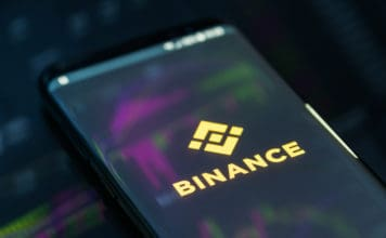 KYRENIA, CYPRUS - SEPTEMBER 21, 2018 Binance mobile app on running on smartphone. Binance is a leading cryptocurrency exchange founded by Changpeng Zhao in august 2017. Source: shutterstock.com