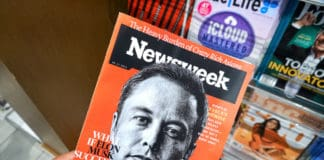 MIAMI, USA - AUGUST 23, 2018 Newsweek magazine with Elon Musk on main page in a hand. Newsweek is an American famous and popular weekly magazine