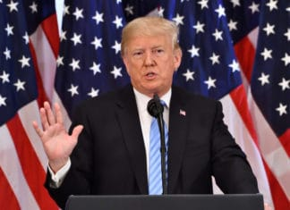 NEW YORK, NY - SEPTEMBER 26, 2018 Donald Trump, the President of the United States addresses reporters on the sidelines of the UN General Assembly at the Lotte Palace Hotel. Source; shutterstock.com