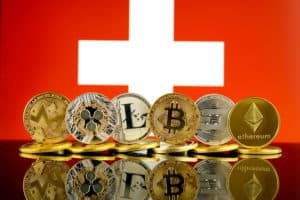 Physical version of Cryptocurrencies (Monero, Ripple, Litecoin, Bitcoin, Dash, Ethereum) and Switzerland Flag. Source; shutterstock.com