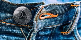 The coin tron instead of buttons on jeans. new fashion.
