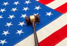Wooden judge gavel over USA flag - studio shoot. Source; shutterstock.com