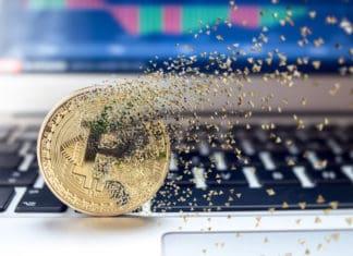 Bitcoin fail concept, Physical golden bitcoin bursting disperse in pieces fragments