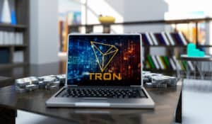 Golden Tron Coin Logo Write Laptop On Living Room Background. 3D Illustration Of Gold Tron Coin Sing.