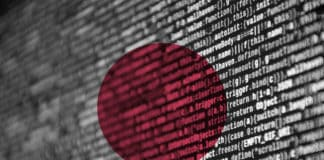 Japan flag is depicted on the screen with the program code. The concept of modern technology and site development