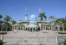 KUALA LUMPUR, MALAYSIA - JANUARY 15, 2015 The Sultan Haji Ahmad Shah Mosque or UIA Mosque in the International Islamic University Malaysia and surrounded by greenery and flora.