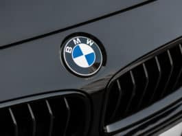 Kyiv, Ukraine - March 4th, 2017 Bmw motor company badge on the front from a black car. BMW is a German automobile, motorcycle and engine manufacturing company founded in 1916