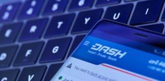 New york, USA - July 6, 2018 Dashcoin crypto wallet menu on smartphone screen lay on laptop keyboard