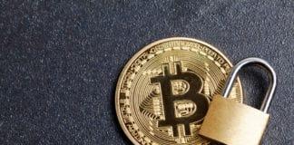 bitcoin security concept. Gold coin with padlock