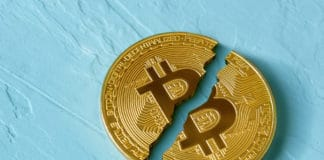 Coin bitcoin is broken in half. The fall and collapse of the course of the crypto currency, the ban on trade - Image