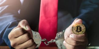 Golden bitcoin in hand of Businessman with handcuff. - Image