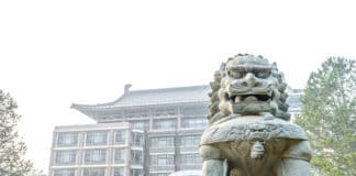 Guardian lion in campus. Located in Peking University, Beijing, China.