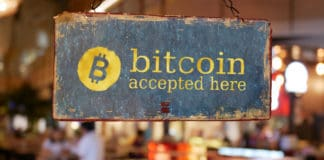 sign bitcoin accepted here hanging in front of restaurant door. bitcoin , electronic money concept - Image