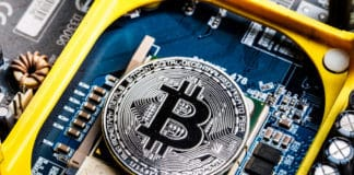 Concept of Bitcoin Mining. Physical bit coin. Digital currency. Cryptocurrency. Silver bitcoins symbol of Blockchain technology and network concept. - Image
