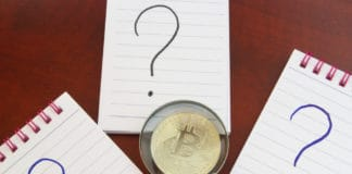 Financial analysis of bitcoin, review bitcoin and questions about crypto currency concept. Bitcoin question marks and magnifying glass - Image