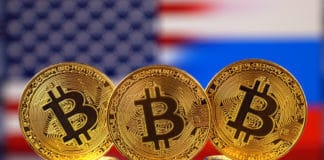 Physical version of Bitcoin (new virtual money), USA and Russia Flag. - Image