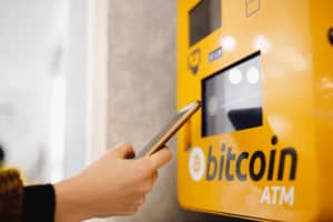 Contactless ATM machine for payment by Bitcoin cryptocurrency. Concept pay mobile phone. - Image
