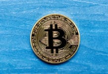 Golden Bitcoin Coin Close Up on a blue wooden background - Image