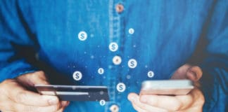 Online banking businessman using smartphone with credit card Fintech and Blockchain concept - Image
