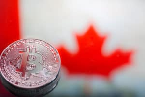 coins Bitcoin, against the background of Canada flag, concept of virtual money, close-up. Conceptual image of digital crypto currency. - Image