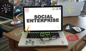 drawing icon cartoon with SOCIAL ENTERPRISE concept on laptop in the office , business concept - Image