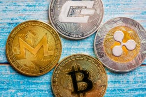 Bitcoin, dash , monero, riplle on the blue table. Crypto currency - Image