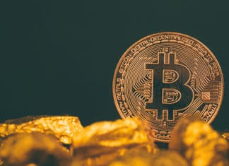 Closeup of bitcoin digital currency and gold nugget or gold ore on black background, precious stone or lump of golden stone, Cryptocurrency money financial and business concept idea. - Image