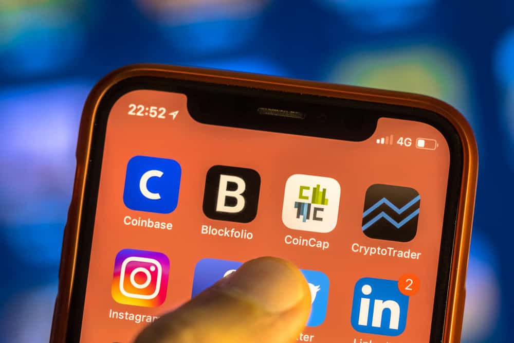 NEW YORK, USA - NOVEMBER 7, 2017 Crypto currency app icons on new smartphone display close-up around other social media iphone applications - Image