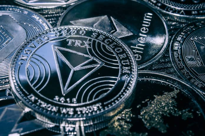 Coin cryptocurrency Tron on the background of the main altcoins Ethereum, dash, monero, litecoin, Iota. - Image