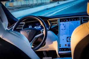 Dubai United Arab Emirates - 08032018 Interior of the Tesla Model S P100D electric car on an empty road in Dubai at sunset - Image