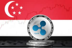 RIPPLE (XRP) cryptocurrency; physical concept ripple coin on the background of the flag of Singapore - Image