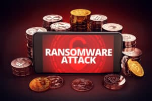 Ransomware attack warning displayed on smartphone screen. Surrounded by different cryptocurrencies piles around. 3D rendering - Illustration