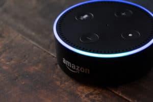 TOKYO, JAPAN - JUNE 28TH, 2018. Amazon's Echo Dot, Alexa virtual assistant on wooden board. - Image
