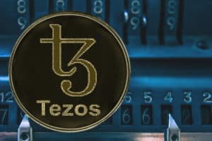 Coin cryptocurrency Tezos and the numbers of the arithmometer. The concept of XTZ. - Image